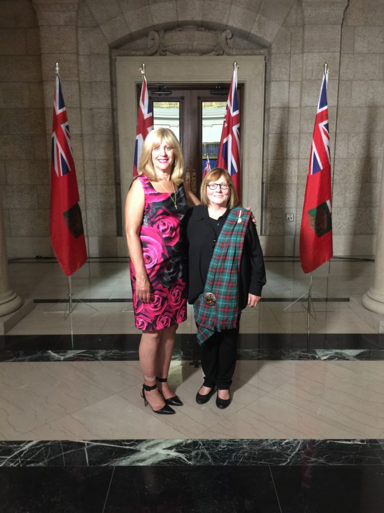 Cathy Cox, Minister of Sport, Culture and Heritage and Joyce Neyedly, President Manitoba Highland Gathering